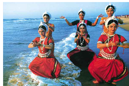 Indian dancers on the beach